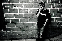 Aaron makes a phone call after the skateboarding has stopped for the night at the Danger Room.................
