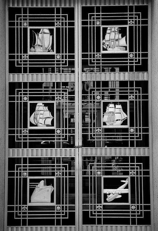 Art Deco grilles adorned with vessels of commerce - ships, train, airplane.