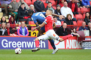 Charlton Athletic midfielder and captain, Jordan Cousins (8) battling for ball with Birmingham City striker, Clayton Donaldson (9) during the Sky Bet Championship match between Charlton Athletic and Birmingham City at The Valley, London, England on 2 April 2016. Photo by Matthew Redman.