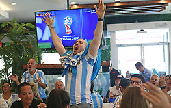 June 21, 2018 - Miami Beach, FL, USA - Juan Gamero, a fan of Argentina's national soccer team, shows his support as he watches a television broadcast of the Russia 2018 World Cup match between Argentina and Croatia at Manolo on Thursday, June 21, 2018 in Miami Beach, Fla. Croatia won 3-0. (Credit Image: © David Santiago/TNS via ZUMA Wire)