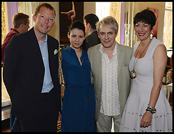 Duran Duran band Member Nick Rhodes with his Girlfriend Nefer Suvio (centre) and Nat Rothschild (left) and Ghislaine Maxwell (right) attend the National Youth Orchestra of The United States of America Reception at the <br /> The Royal Albert Hall hosted by Ronald O.Perelman, London, United Kingdom,<br /> Sunday, 21st July 2013<br /> Picture by Andrew Parsons / i-Images