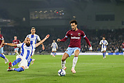 West Ham United midfielder Felipe Anderson (8) and Brighton and Hove Albion defender Bruno (2) sliding tackle during the Premier League match between Brighton and Hove Albion and West Ham United at the American Express Community Stadium, Brighton and Hove, England on 5 October 2018.