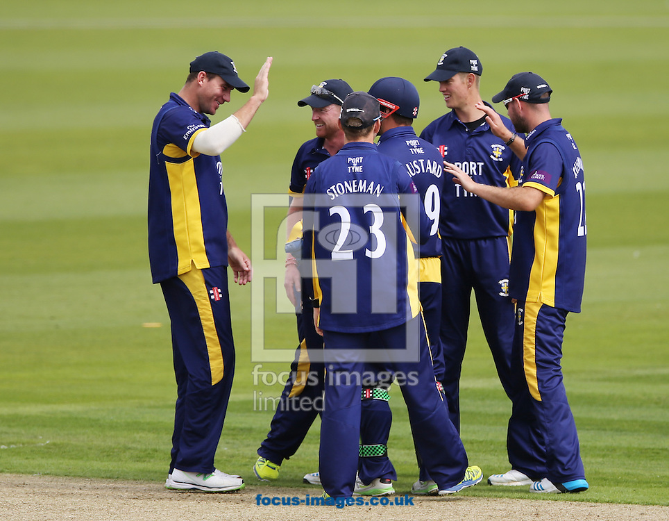Durham County Cricket Club celebrate a wicket during the Royal London One Day Cup match at Emirates Durham ICG, Chester-le-Street<br /> Picture by Simon Moore/Focus Images Ltd 07807 671782<br /> 14/08/2014