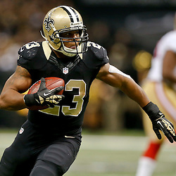 Nov 17, 2013; New Orleans, LA, USA; New Orleans Saints running back Pierre Thomas (23) runs after a catch during the second quarter of a game against the San Francisco 49ers at Mercedes-Benz Superdome. Mandatory Credit: Derick E. Hingle-USA TODAY Sports