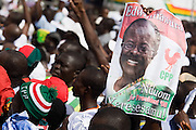 Convention People's Party (CPP) supporters hold a poster picturing presidential candidate Paa Kwesi Nduom during a rally in Accra, Ghana on Sunday September 21, 2008.