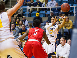 Dec 20, 2016; Morgantown, WV, USA; West Virginia Mountaineers guard James Bolden (3) passes to West Virginia Mountaineers forward Nathan Adrian (11) during the second half against the Radford Highlanders at WVU Coliseum. Mandatory Credit: Ben Queen-USA TODAY Sports