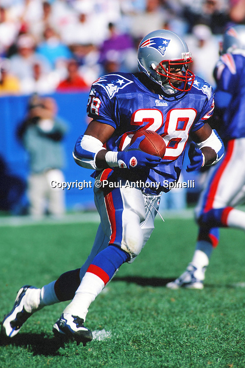 New England Patriots running back Curtis Martin (28) runs the ball during the NFL football game against the Chicago Bears on Sept. 21, 1997 in Foxborough, Mass. The Patriots won the game 31-3. (©Paul Anthony Spinelli)