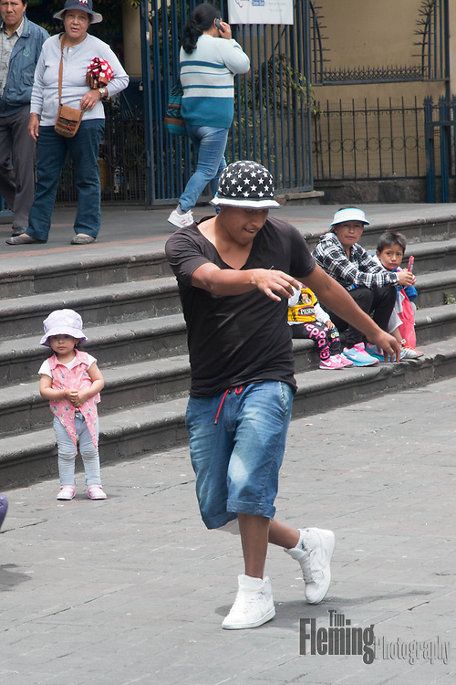 Young man dancing to music in Quito, Ecuador