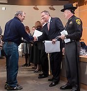 Goshen, New York - Orange County District Attorney David Hoovler, second from right, shakes hands with a new American citizen during a Naturalization ceremony at the county Emergency Services Center on Nov. 17, 2016.