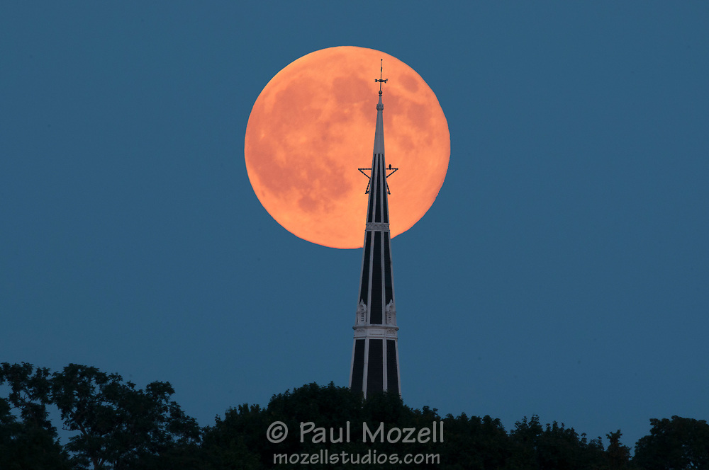 "Full ""Super"" moon over the Baptist Church of Wakefield, MA. In November 2018 a lightning bolt struck the 180 foot church spire, and the 150 church burned to the ground.<br />