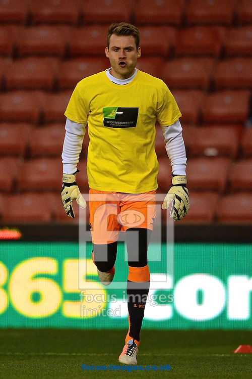 Picture by Ian Wadkins/Focus Images Ltd +44 7877 568959<br /> 12/01/2014<br /> Simon Mignolet of Liverpool warms up ahead of the Barclays Premier League match at the Britannia Stadium, Stoke-on-Trent.