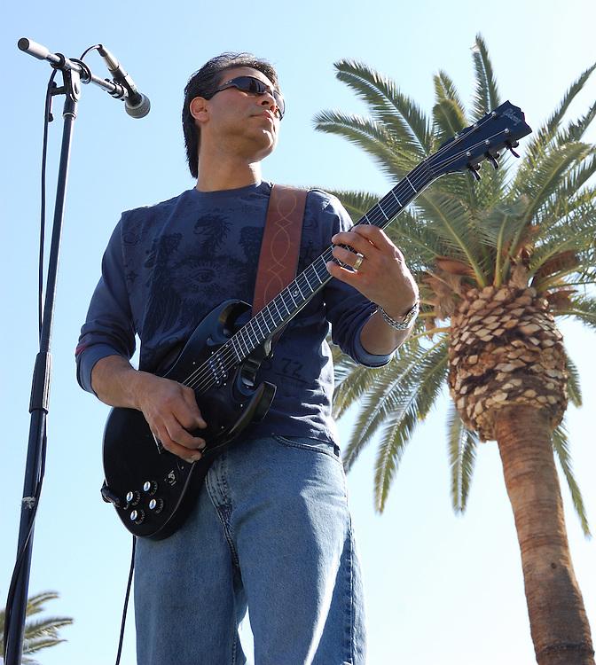 Richard Rivera plays guitar during the Spirit Familia concert at Carnaval Spring Festival in Tucson, Arizona.