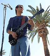 Richard Rivera plays guitar during the Spirit Familia concert at Carnaval Spring Festival in Tucson, Arizona. Event photography by Martha Retallick.