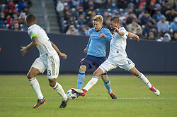 March 11, 2018 - Bronx, New York, United States - Los Angeles Galaxy defender PERRY KITCHEN (2) and New York City FC defender ANTON TINNERHOLM (3) fight for the ball while Los Angeles Galaxy defender ASHLEY COLE (3) looks on during a regular season match at Yankee Stadium in Bronx, NY.  NYCFC defeats LA Galaxy 2 to 1. (Credit Image: © Mark Smith via ZUMA Wire)