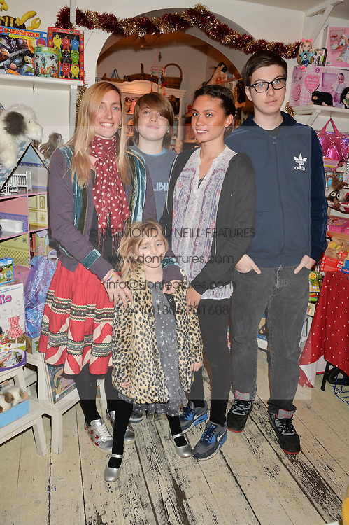 HONEY BOWDREY with her children at a promotional party for the A Girl For All Time doll held at HoneyJam, 2 Blenheim Crescent, London on 5th December 2015.