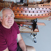 Michael Demonte poses with a model ship at his home in Leland. (Jason A. Frizzelle)