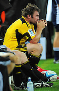 Hurricanes captain Andrew Hore watches his team lose from the bench. Super 15 rugby match - Hurricanes v Highlanders at Westpac Stadium, Wellington, New Zealand on Friday, 18 February 2011. Photo: Dave Lintott/PHOTOSPORT