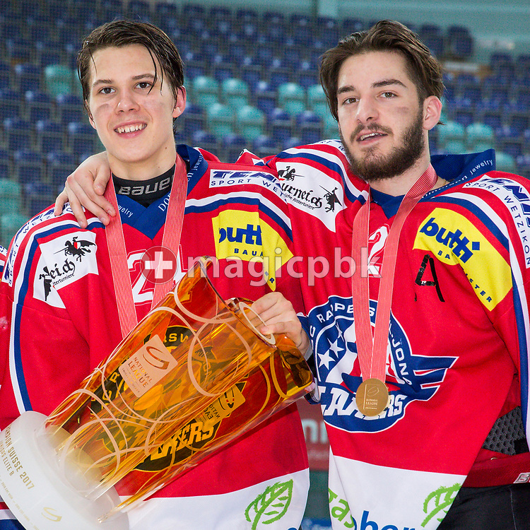 (L-R) Rapperswil-Jona Lakers defenseman Lars Mathis and Joel Brotzge pose for a photo with their gold medals and the Swiss Champion trophy after winning the fifth Elite B Playoff Final ice hockey game between Rapperswil-Jona Lakers and ZSC Lions held at the SGKB Arena in Rapperswil, Switzerland, Sunday, Mar. 19, 2017. (Photo by Patrick B. Kraemer / MAGICPBK)