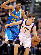 Apr 7, 2013; Phoenix, AZ, USA; Phoenix Suns guard Goran Dragic (1) handles the ball against the New Orleans Hornets forward Anthony Davis (23) in the second half at US Airways Center. The Hornets defeated the Suns 95-92. Mandatory Credit: Jennifer Stewart-USA TODAY Sports