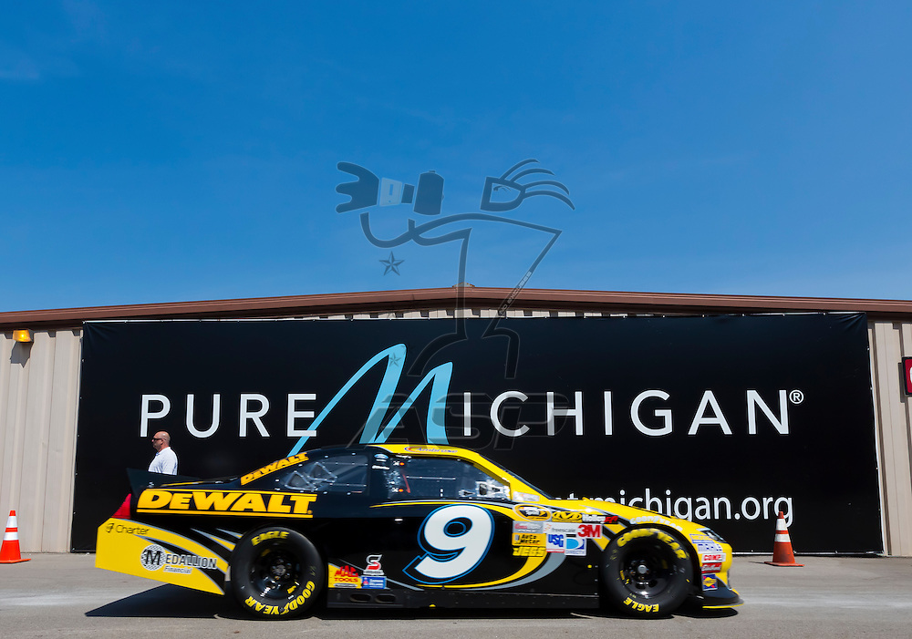 BROOKLYN, MI - JUN 15, 2012:  Marcos Ambrose (9) brings his car back into the garage area during a practice for the Quicken Loans 400 at the Michigan International Speedway in Brooklyn, MI.