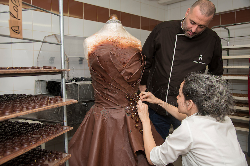LYON, FRANCE - OCTOBER22: Chocolate dress for Marion Bartoli, by Philippe Bernachon. Chocolate maker Philippe Bernachon and designer Florencia Soerensen collaborate to create a chocolate dress on October 22, 2013 in Lyon, France. The six kilogram chocolate dress is made from golden leafs and savage silk and is to be worn by former professional tennis player Marion Bartoli at the Paris chocolate trade show 'Salon du Chocolat' on October 29 at Porte de Versailles on October 22, 2013 in Lyon, France.(Photo by Bruno Vigneron/Getty Images)