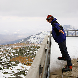 Matt Heid leaning into 50 mph winds on Mount Washington, New Hampshire.  Observation deck. March.