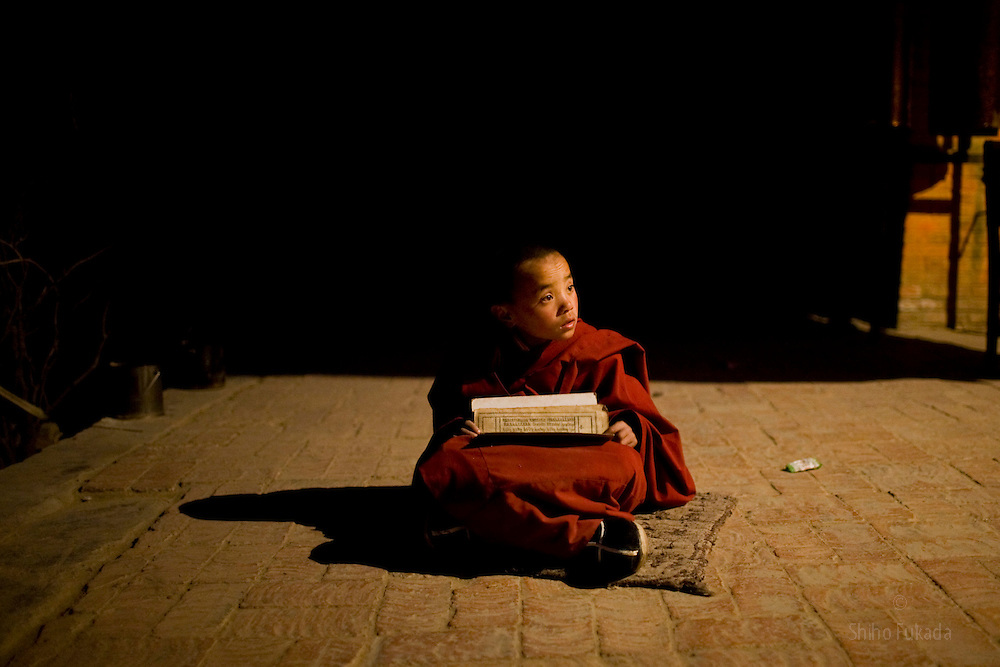 Tibet New Year - China - Edward Wong<br /> A child monk studies at Rongwo monastery  (Longwu in Chinese) in Rebkong (Tongren in Chinese), Qinghai province in China, February 23, 2009. Photo by Shiho Fukada for The New York Times