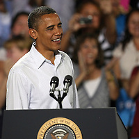 President Barack Obama laughs with the audience during his Grassroots event at the Kissimmee Civic Center in Kissimmee, Florida on Saturday, September 8, 2012. (AP Photo/Alex Menendez)