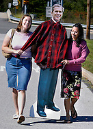 Katie Cosky (L), 18, of Washington Twp., New Jersey, and Brittani McKenna, 20, of Dover, Delaware carry a replica of U.S. President George W. Bush on their way to hear Bush speak at the Valley Forge Convention Center September 22, 2004 in King of Prussia, Pennsylvania. (Photo by William Thomas Cain/photodx.com)