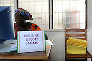 Benin February 29, 2008 -  Woman working at the Supreme Court Chamber of the urban district of Lokossa