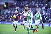 Man of the match Christophe Berra beats Olly Shaw to the ball during the William Hill Scottish Cup 4th round match between Heart of Midlothian and Hibernian at Tynecastle Stadium, Gorgie, Scotland on 21 January 2018. Photo by Kevin Murray.