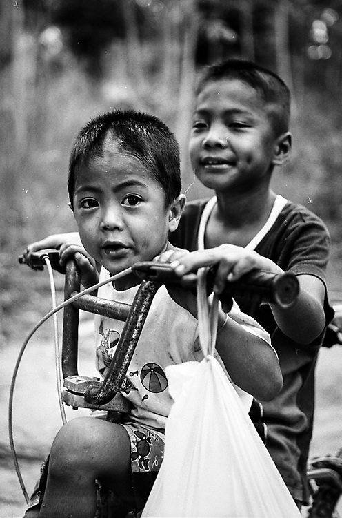 I photographed this two young Burmese brothers living in the island of Ko Chang near Ranong in Southern Thailand. Due to the vicinity of the border, some family migrate here from Myanmar in search of opportunity. Photo by Lorenz Berna