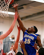 Emmitt Holt of Webster Schroeder leaps for a rebound during a game at Penfield High School on Friday, January 24, 2014.