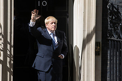 London, UK. 24 July, 2019. Boris Johnson waves from the doorstep of 10 Downing Street after having been appointed Prime Minister by the Queen at Buckingham Palace.