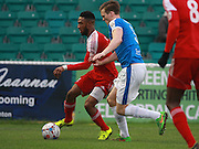 Whitehawk defender Craig Braham-Barrett shields the ball from Dover defender Sean Raggett during the FA Trophy match between Whitehawk FC and Dover Athletic at the Enclosed Ground, Whitehawk, United Kingdom on 12 December 2015. Photo by Bennett Dean.