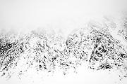 A storm envelopes the eastern slope of Mt. Tom, near Bishop, CA.