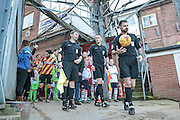 Eddie Ilderton (Referee), James Bell (Assistant Referee) and Michael Webb (Assistant Referee) lead the players out before the EFL Sky Bet League 1 match between Bradford City and Bolton Wanderers at the Coral Windows Stadium, Bradford, England on 18 February 2017. Photo by Mark P Doherty.