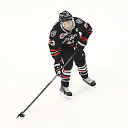 Colton Saucerman #23 of the Northeastern Huskies with the puck during The Beanpot Championship Game at TD Garden on February 10, 2014 in Boston, Massachusetts. (Photo by Elan Kawesch)
