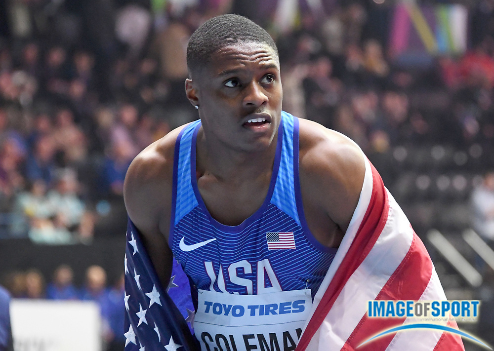 Mar 3, 2018; Birmingham, United Kingdom; Christian Coleman (left) and Ronnie Baker (USA) poses with United States flag after winning the 60m in a championship record 6.37 during the IAAF World Indoor Championships at Arena Birmingham.