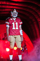 20 September 2010: Quarterback (11) Alex Smith of the San Francisco 49ers runs out of the tunnel during player introductions before the New Orleans Saints 25-22 victory over the 49ers at Candlestick Park in San Francisco, CA.