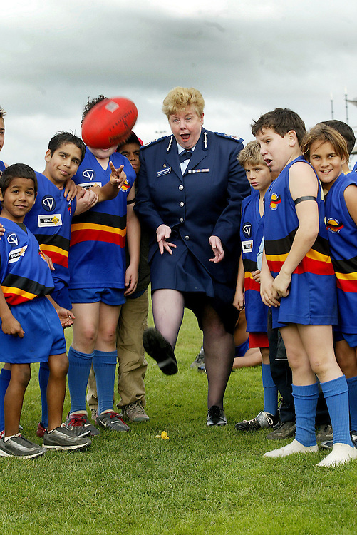csz030712.001.001.jpg. Digicam000. Police Chief Commissioner Christine Nixon with Sheppartons Rumbalara under 14 s football club members after their game against Benalla.  The Chief Commissioner was made number one supporter today by the club. Pic By Craig Sillitoe SPECIAL 000 melbourne photographers, commercial photographers, industrial photographers, corporate photographer, architectural photographers, This photograph can be used for non commercial uses with attribution. Credit: Craig Sillitoe Photography / http://www.csillitoe.com<br />