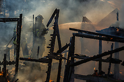 October 25, 2016 - Calais, France - Firefighters extinguish during the eviction of the Calais Jungle a hut which was set on fire  in Calais, France, on 25 October 2016. Up to the evening, about 4,000 migrants from the Refugee camp on the coast at the English Channel were distributed to several regions in France. The police have begun to tear down the huts and tents in the camp. (Credit Image: © Markus Heine/NurPhoto via ZUMA Press)