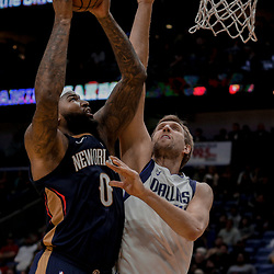 Dec 29, 2017; New Orleans, LA, USA; New Orleans Pelicans center DeMarcus Cousins (0) shoots over Dallas Mavericks forward Dirk Nowitzki (41) during the second half at the Smoothie King Center. The Mavericks defeated the Pelicans 128-120.  Mandatory Credit: Derick E. Hingle-USA TODAY Sports