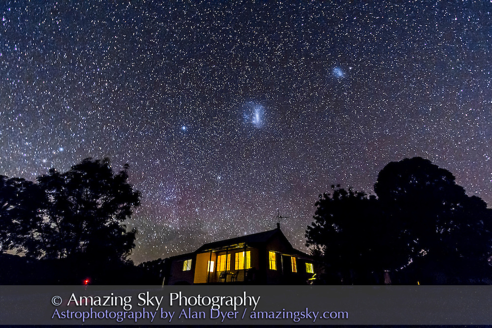 Timor Cottage at Coonabarabran, NSW, Australia, under dark skies with Large and Small Magellanic Clouds above the cottage. Taken Dec. 5, 2012 using Canon 60Da and 10-22mm lens at 10mm and f/3.5 for 1 minute exposure, untracked, at ISO 2000.