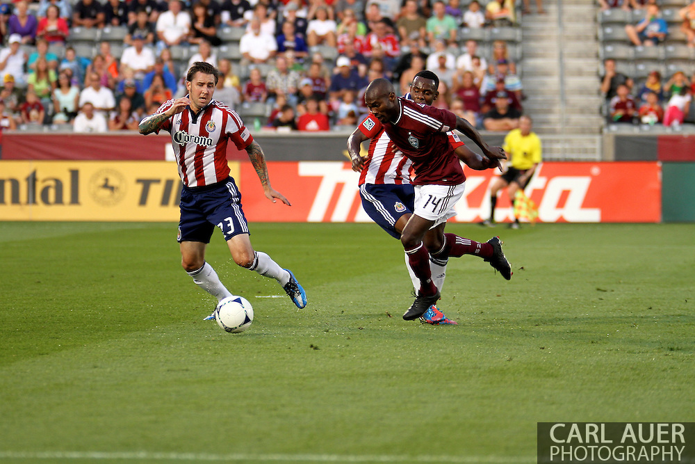 August 18th, 2012: Colorado Rapids forward Omar Cummings (14) tries to get free from the Chivas USA defense for a shot in the first half at Dick's Sporting Goods Park