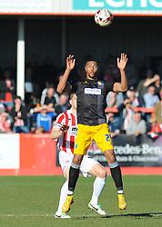Mansfield Town's  Billy Kee wins the high-ball against Cheltenham Town's Matt Taylor - Photo mandatory by-line: Nizaam Jones  - Mobile: 07966 386802 - 07/03/2015 - SPORT - Football - Cheltenham - Whaddon Road- Cheltenham Town v Mansfield - Sky Bet League Two
