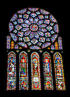 Our Lady of Chartres Cathedral, Chartres, France.  Dedicated to the Virgin, the central oculus shows the Virgin and Child and is surrounded by 12 small petal-shaped windows, 4 with doves, the rest with angels carrying candlesticks. Beyond this is a ring of 12 diamond-shaped openings containing the Old Testament Kings of Judah, another ring of smaller lozenges containing the arms of France and Castille, and finally a ring of semi-circles containing Old Testament Prophets holding scrolls. Beneath the rose itself are five tall lancet windows showing, in the centre, the Virgin as an infant held by her mother, St Anne. There are four more lancets containing Old Testament figures.