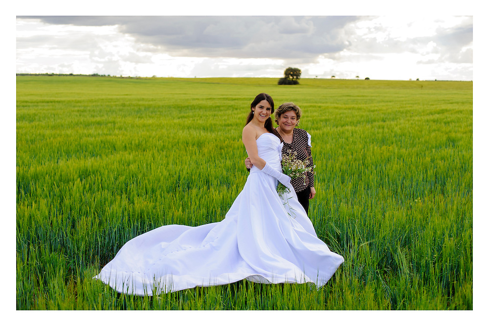 Mother and Daughter in a field of wheat during a trashing of the dress session.