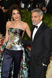 Hollywood star George Clooney was treated in hospital on Tuesday for minor injuries after a scooter accident in Sardinia, Italy on July 10, 2018 ------------ Amal Clooney and George Clooney attend the Costume Institute Benefit at The Metropolitan Museum of Art celebrating the opening of Heavenly Bodies: Fashion and the Catholic Imagination. The Metropolitan Museum of Art, New York City, New York, May 7, 2018. Photo by Lionel Hahn/ABACAPRESS.COM