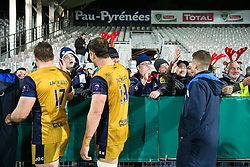 Bristol Rugby supporters celebrate with the players after Bristol Rugby win the game 18-28 - Rogan Thomson/JMP - 16/12/2016 - RUGBY UNION - Stade du Hameau - Pau, France - Pau v Bristol Rugby - EPCR Challenge Cup.